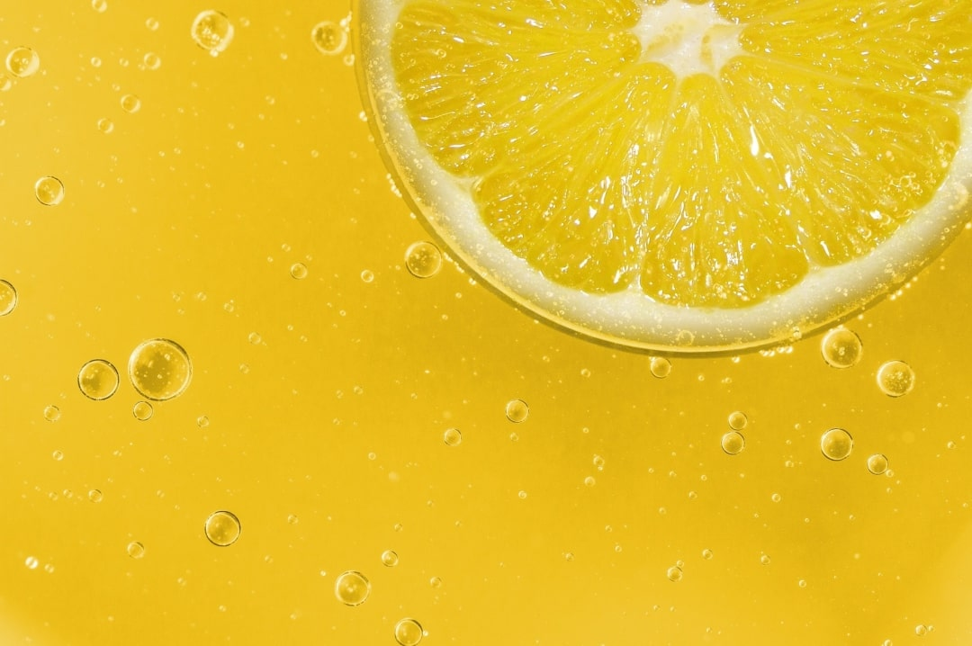 A photograph of a slice of bright yellow lemon floating in some lemonade - 7 Foods That Are Great For Your Health - Mrs H's favourite things
