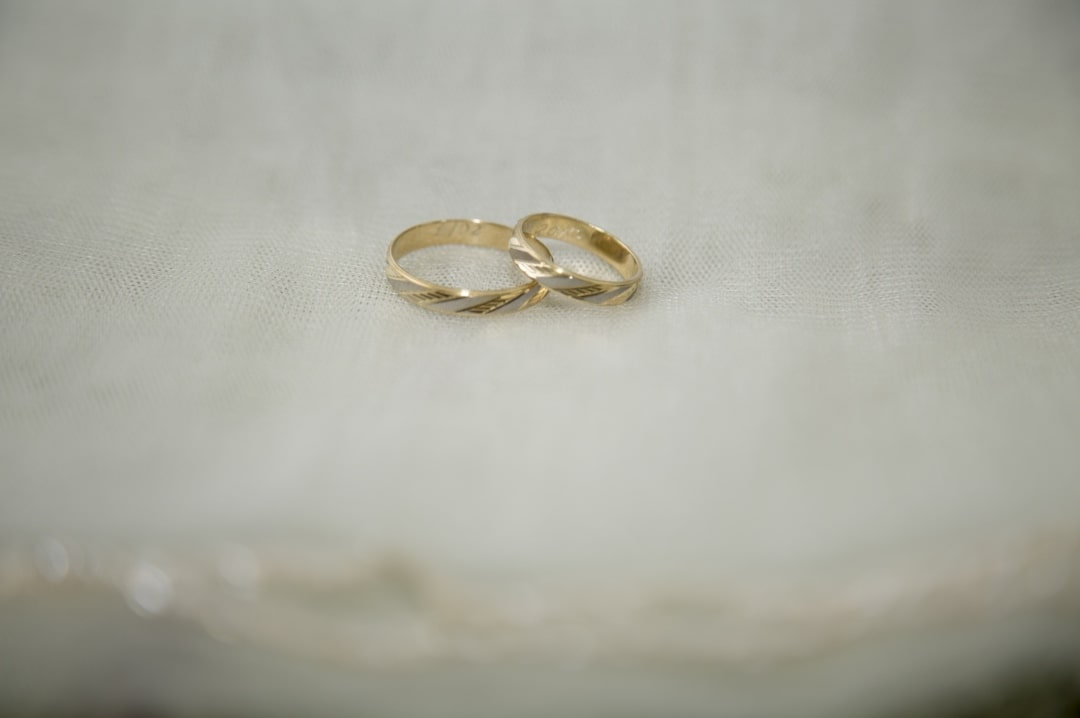 A photograph of two wedding rings on a white background - Anniversary Gifts (With A Twist) - Mrs H's favourite things
