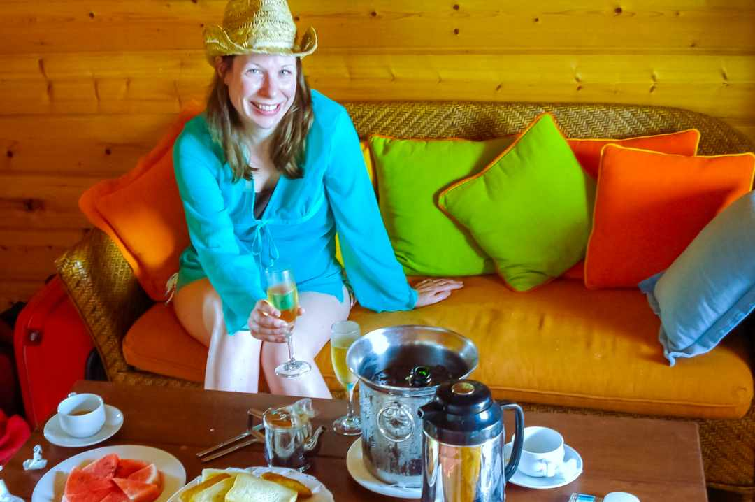 A photograph of a woman having a champagne breakfast on her honeymoon in the maldives - My Favourite Holiday - Our Honeymoon In The Maldives - Mrs H's favourite things