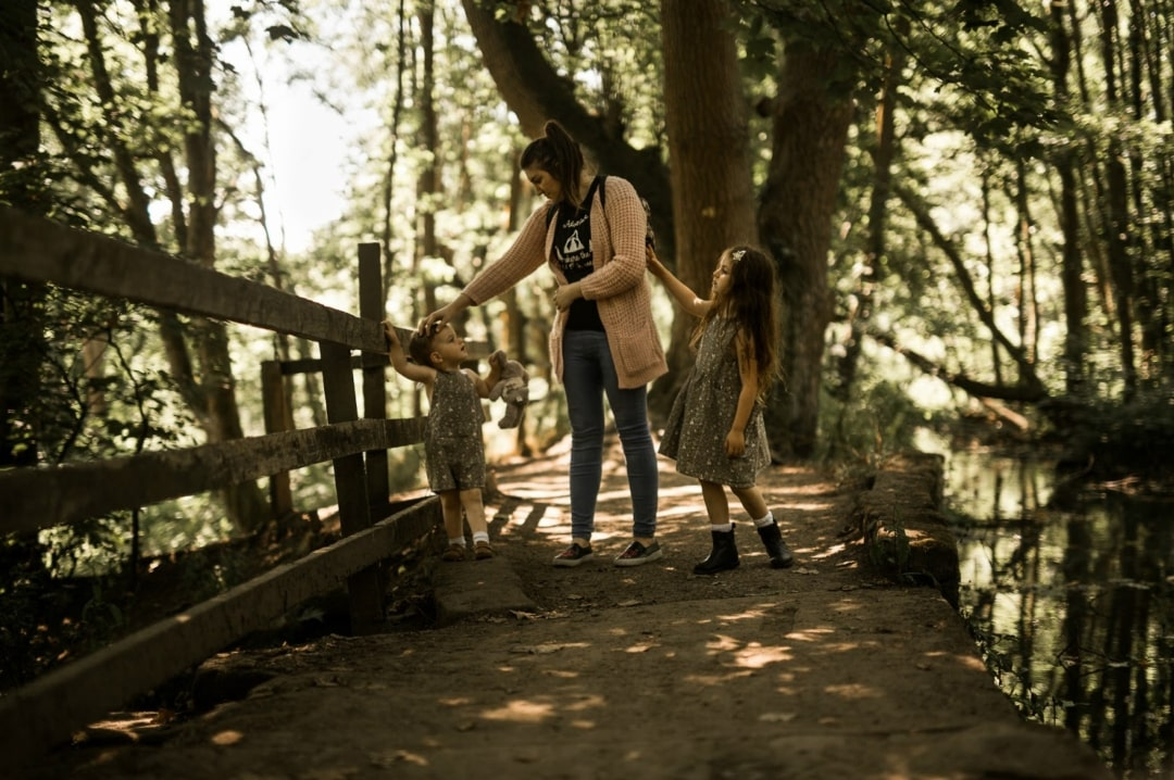 A photograph of a woman in the woods with her two children - My Favourite Bloggers Featuring Lilypad and Bow - Mrs H's favourite things