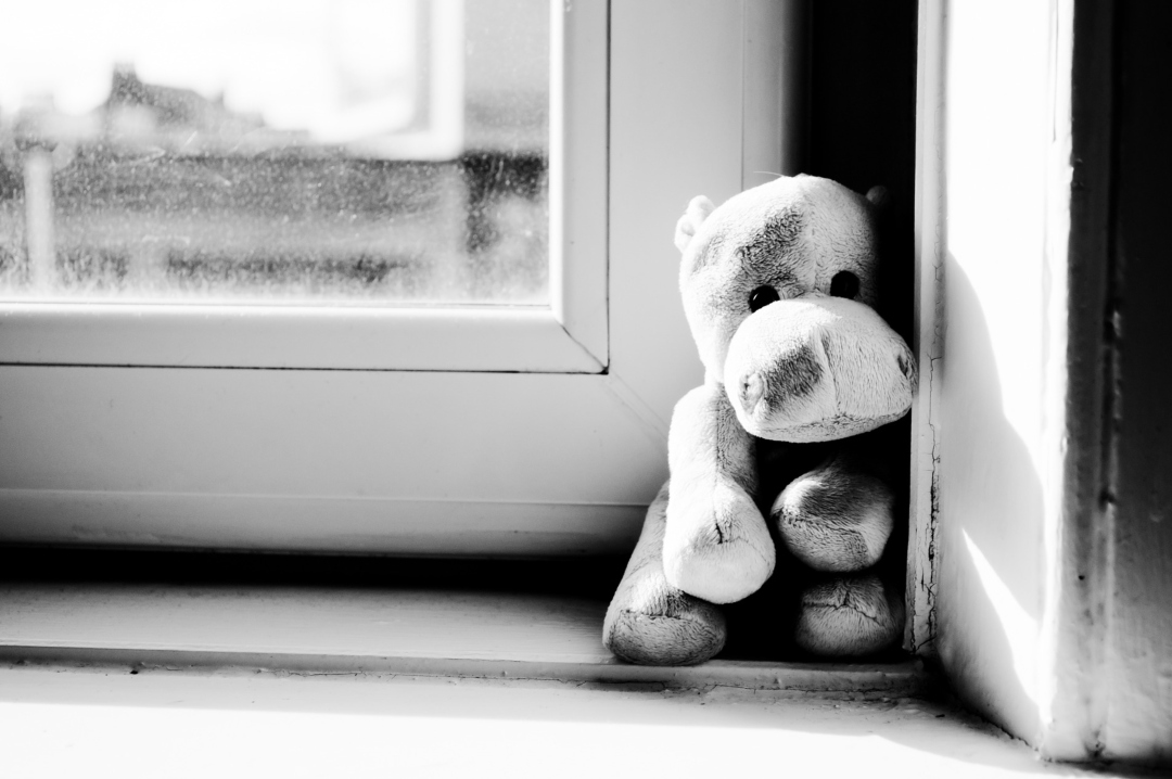 A black and white photograph of a soft toy abandoned on a window sill - Baby Loss - Is It Time To Move On - Mrs H's favourite things