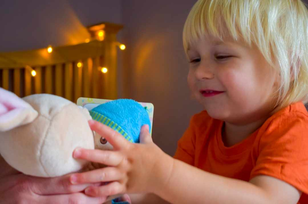 A photograph of a little boy playing with his favourite toy and Robbie The Rabbit from the My First Emotions box - Feeling The Love With Little Mister H and My First Emotions - Mrs H's favourite things