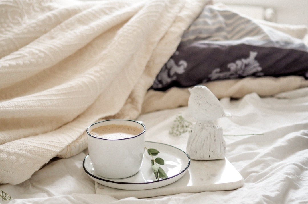 A photograph of someone having a cup of tea in bed - 31 Day Self-Care Challenge - Mrs H's favourite things