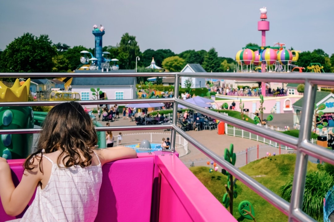 A photograph of a little girl on a ride in Peppa Pig's World at Paulton's Park - My Top Seven Of 2018 - Mrs H's favourite things
