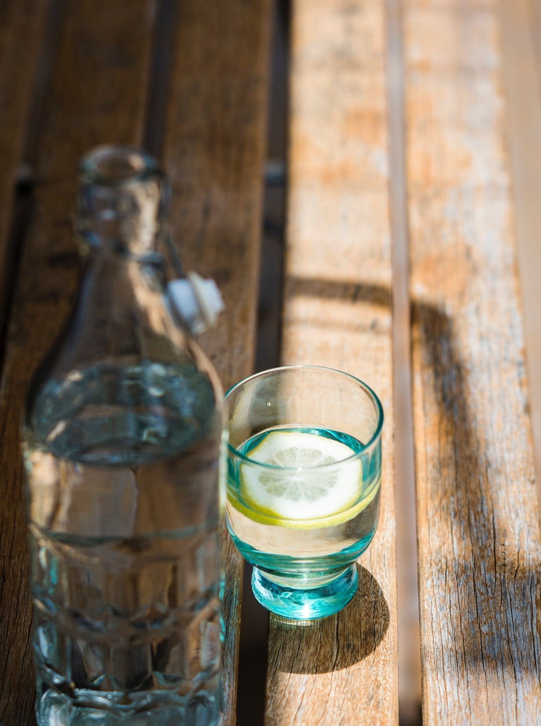 A photograph of a carafe and a glass of water on a wooden table - 7 Simple But Effective Ways To Ensure A Good Mental Health Day - Mrs H's favourite things