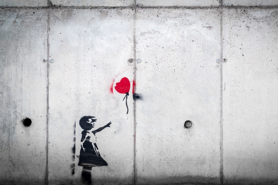 A photograph of a Banksy painting of a little girl with a red heart shaped balloon floating away - Should Miscarriage Form Part Of School Sexual Education Classes? - Mrs H's favourite things