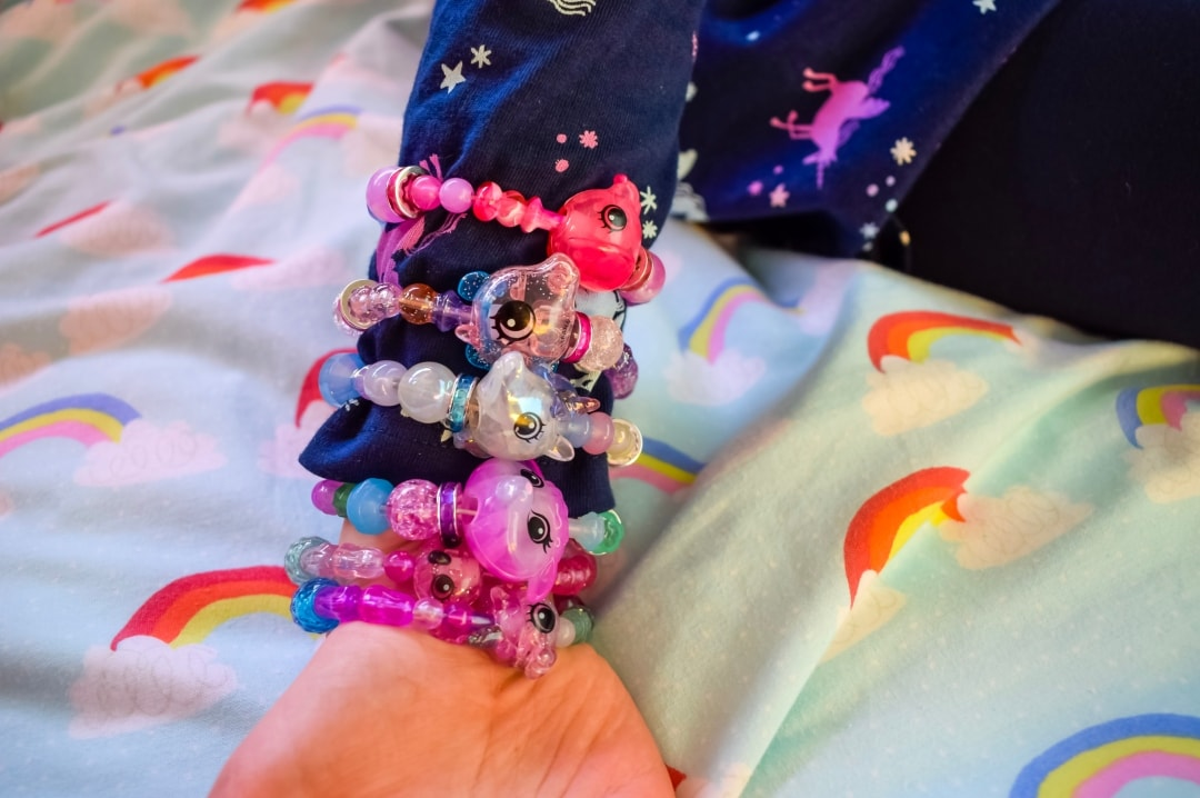 A photograph of a little girl wearing Twisty Petz as bracelets on her arm - Twisty Petz Collectables From Spin Master - A Review - Mrs H's favourite things