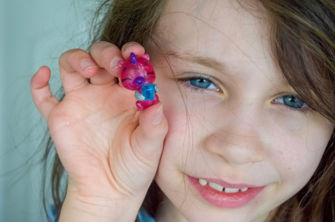 A photograph of a little girl holding up her favourite character from the Hatchimals CollEGGtibles Mermal Magic Season 5 - Hatchimals CollEGGtibles Mermal Magic Season 5 Review - Mrs H's favourite things