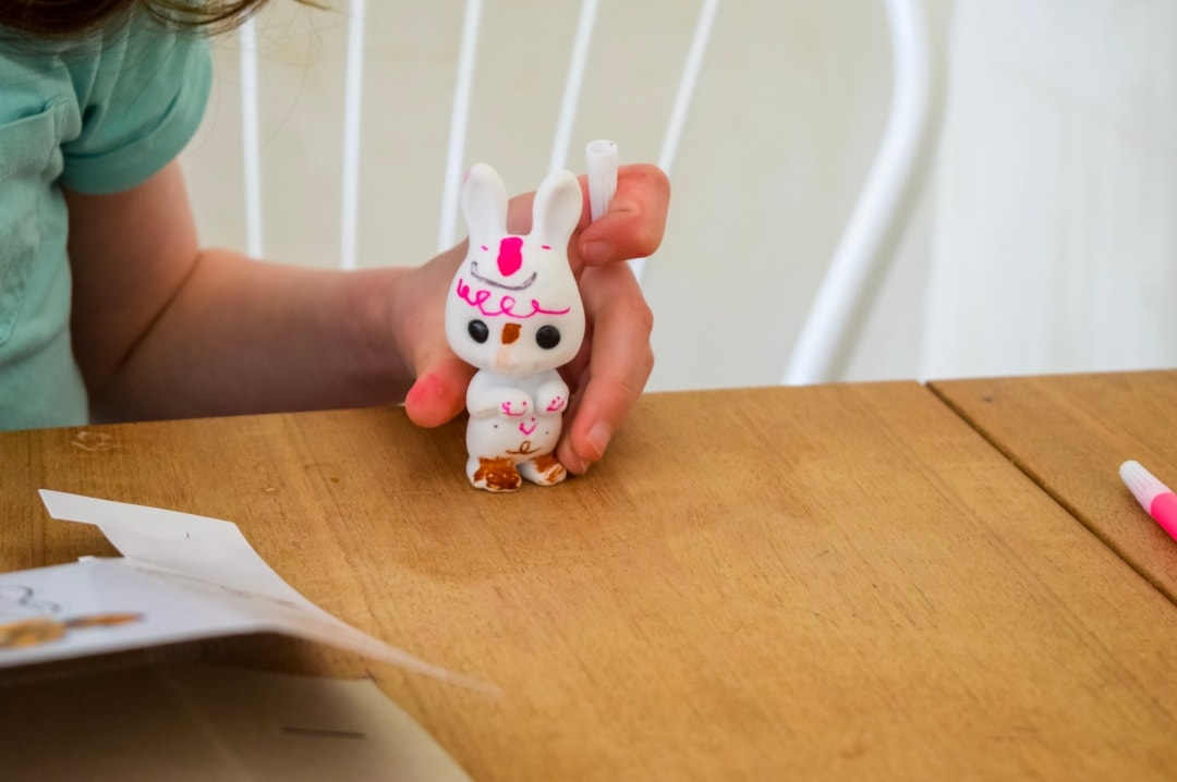 A photograph of a little girl showing off her design on her Fuzzikins Bedtime Bunnies - Fuzzikins Bedtime Bunnies Review - Mrs H's favourite things