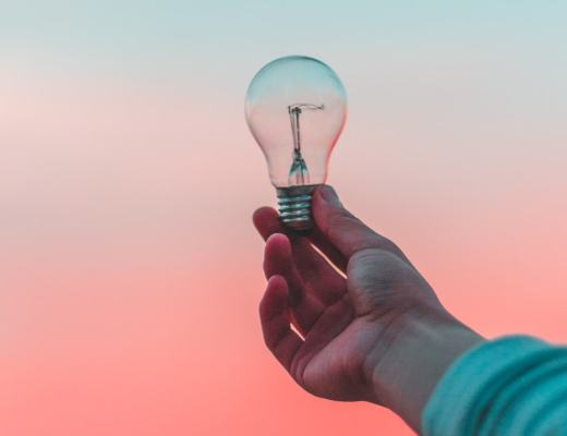 A photogrqaph of a man carrying a light bulb in front of a sunset - 5 Ways To Make Your Home More Accessible - Mrs H's favourite things
