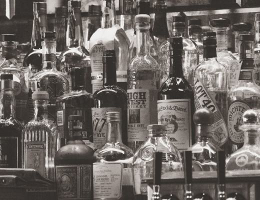 A photograph of lots of bottles of spirits in a bar - Why Giving Up Alcohol Could Be The Best Thing You Do Today - Mrs H's favourite things