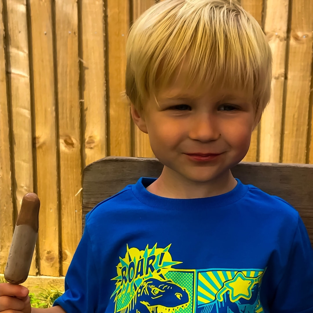A photograph of a little boy giving a cheeky smile and eating an ice cream - A Family Update - Mrs H's favourite things