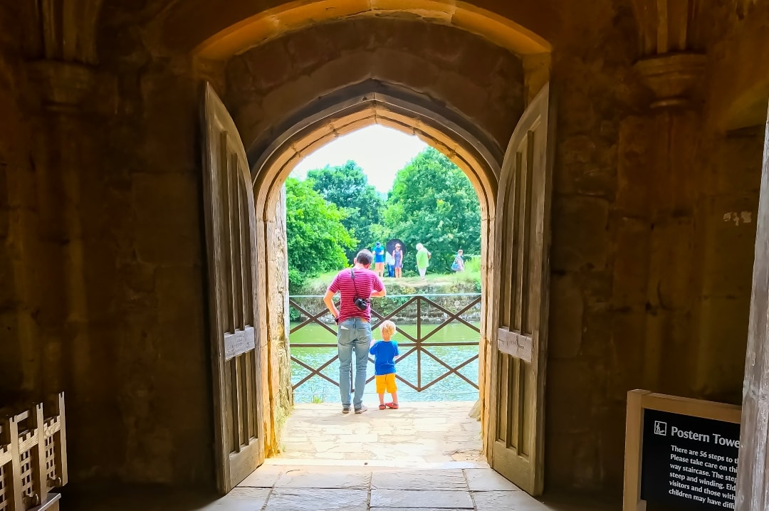 A photograph of a Dad and his young son standing in the doorway of Bodiam Castle - A Family Update - Mrs H's favourite things