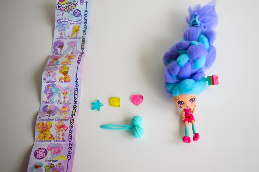 A photograph of the collector's guide, hair accessories and Kelly Bean, a Candylocks Doll - Introducing Candylocks Doll - A Review - Mrs H's favourite things
