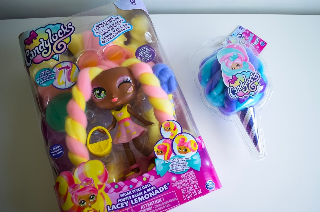 A photograph of two Candylocks Dolls in their packaging - the Deluxe Lacey Lemonade and the smaller Kelly Bean - Introducing Candylocks Dolls - Mrs H's favourite things