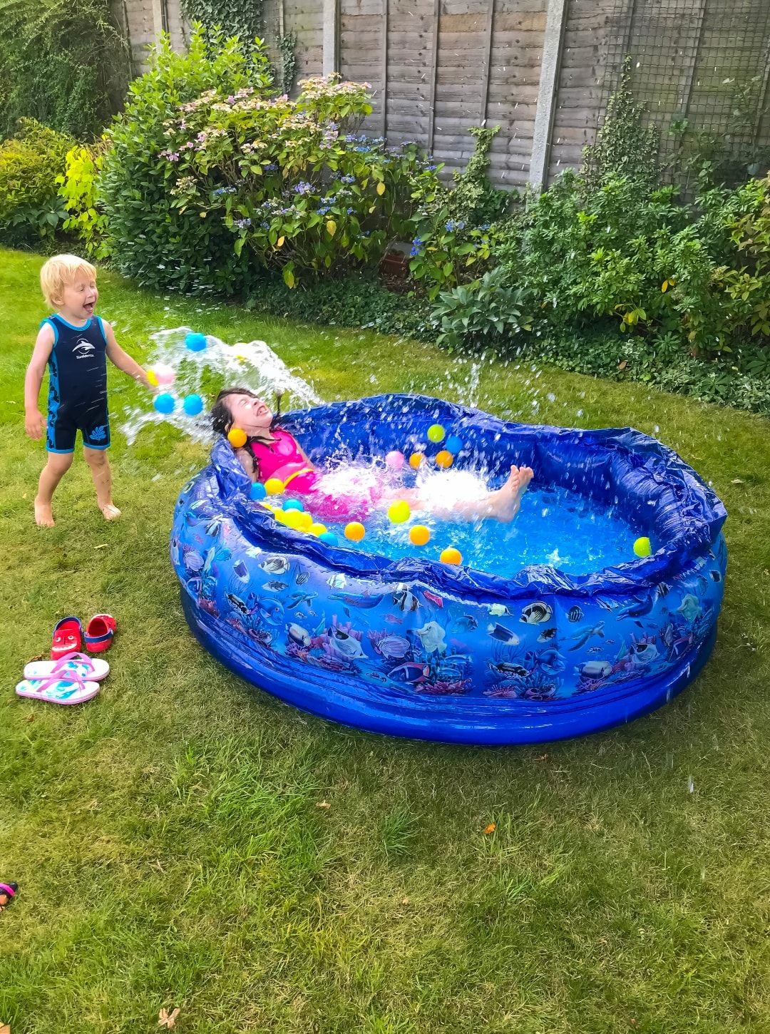 A photograph of a little boy and a little girl playing in a paddling pool - Snapshots Of Our Summer - Mrs H's favourite things