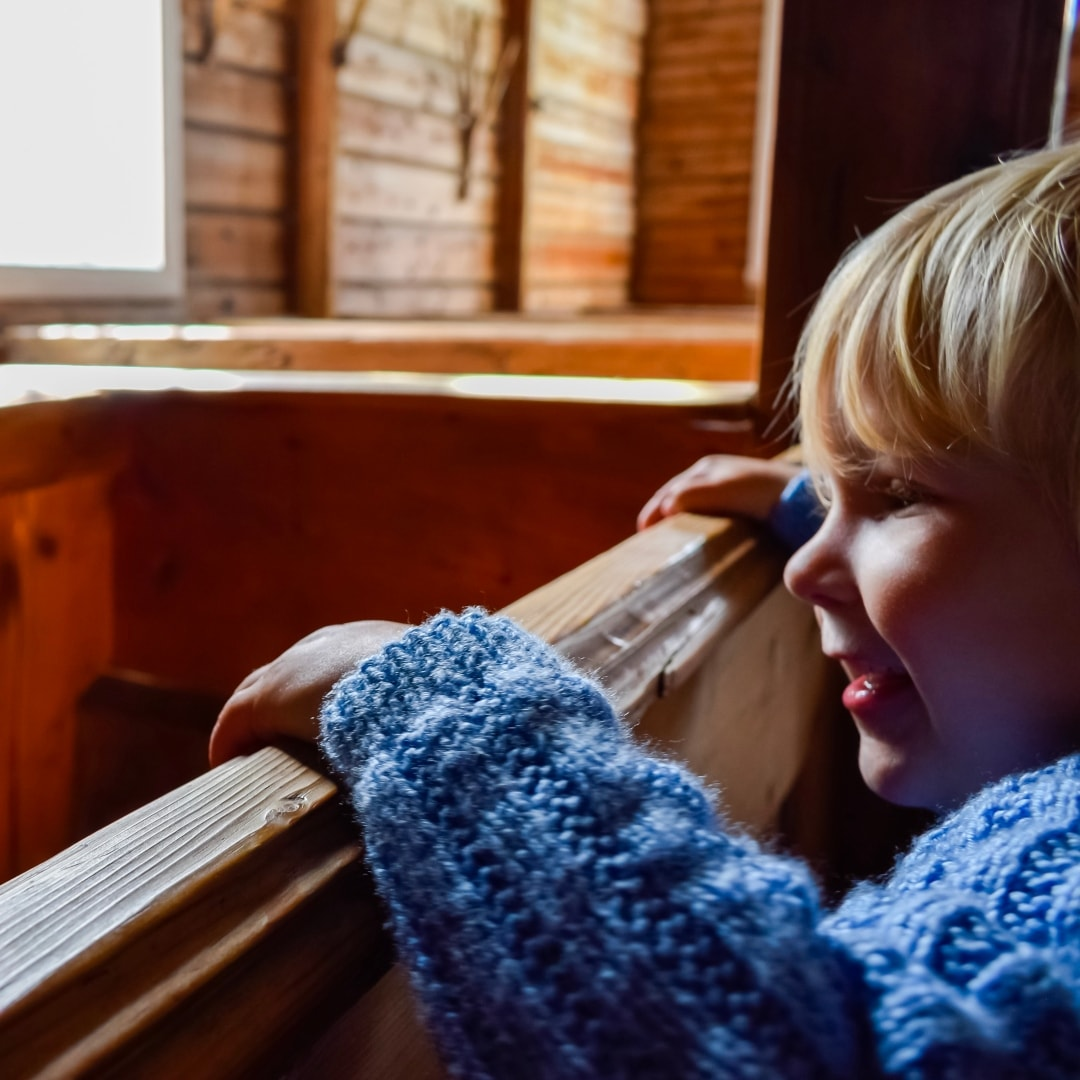 A photograph of a little boy in a church in Olden in Norway - Snapshots Of Our Summer - Mrs H's favourite things