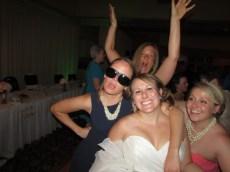 Katie rocking Grandma's Glasses with the bride.