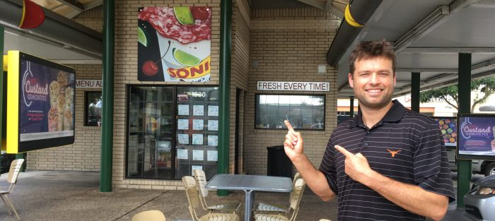 Mr. SkinnyPants stands in front of Sonic preparing to order low carb fast food.