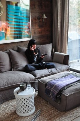 Everything about this picture. Talking on the phone, a comfy couch, watching TV, a beautiful living room decor...