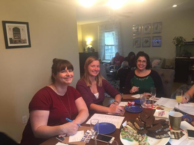 Friends attend a postcard party to write their elected officials