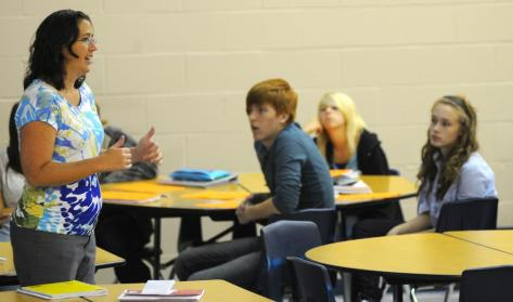 Tribune-Star/Jim Avelis Be careful: Riverton-Parke's Jill Wiram talks with juniors about the care of their new laptop computers.