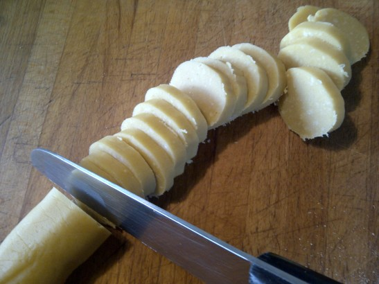 Image of the biscuit dough being cut into slices