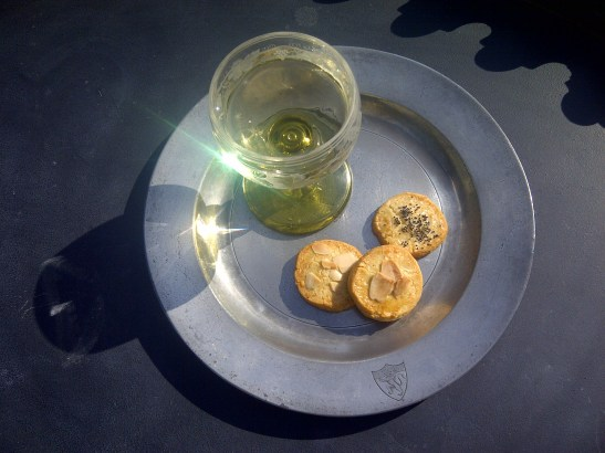 Image of a glass of fino sherry and a selection of sablee biscuits on a pewter plate
