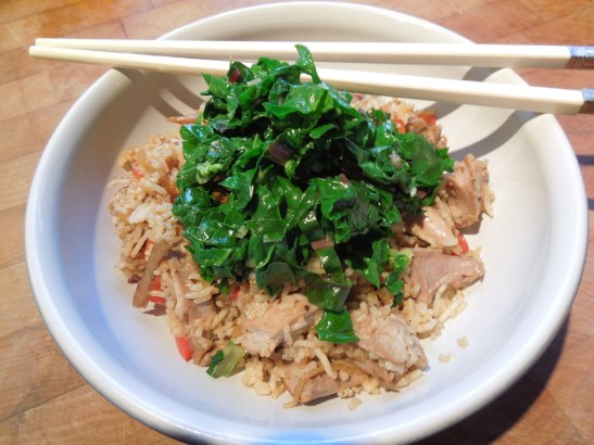 Image of stir-fried greens over a rice dish