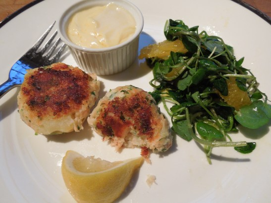 Image of fishcakes served with watercress and orange salad and hollandaise sauce
