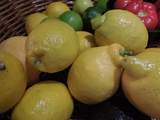 Image of lemons in a basket of mixed fruit
