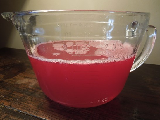 Image of a jug of redcurrant juice