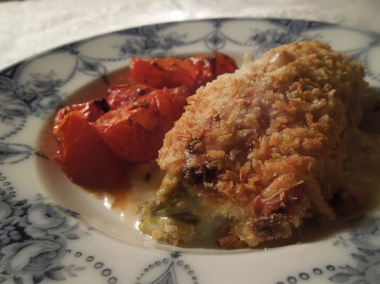 Image of gratin served wit baked tomatoes