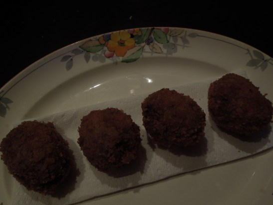 Image of cooked Scotch eggs draining on kitchen paper