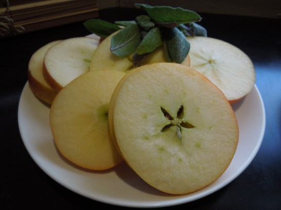 Image of sliced apples and sage leaves