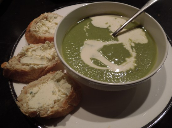 Image of soup served with baguette and herb cheese