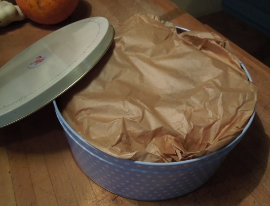 Image of cake wrapped and in tin