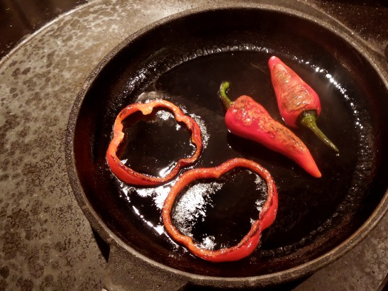 Image of peppers charring in pan