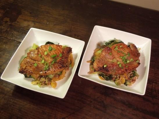 Image of pork steaks served on stir-fried veg