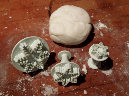 Image of snowflake cutters and icing