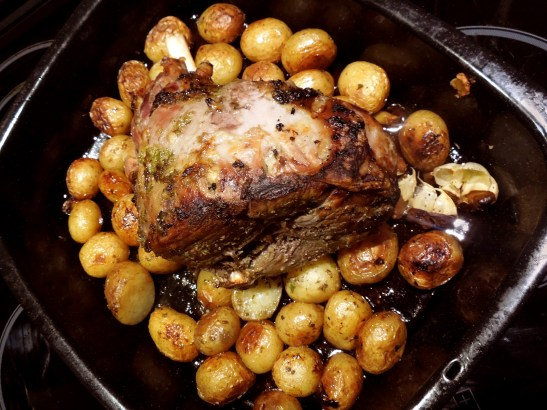Image of Greek Roast Lamb with poatoes, garlic, herbs and lemon