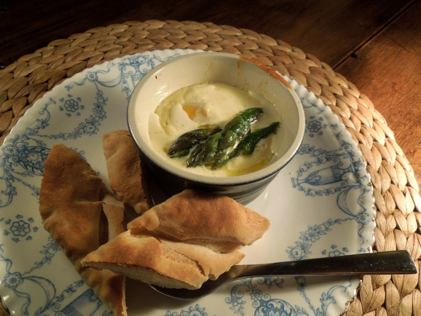 Image of eggs in pots with asparagus