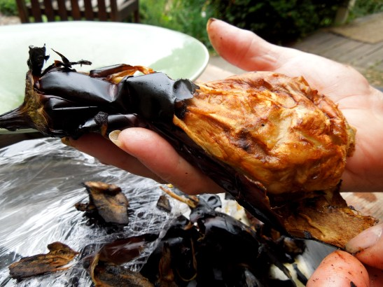 Image of blackened aubergine being peeled