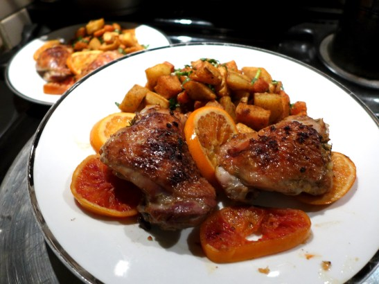 Image of chicken and oranges sderved with spiced root veg