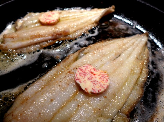 Image of butter added to fish