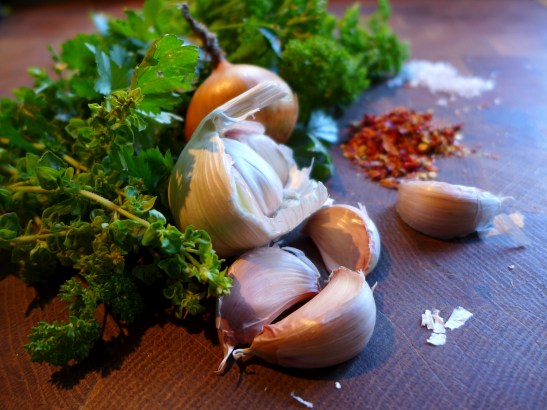 Image of chimichurri ingredients, minus the oil and vinegar