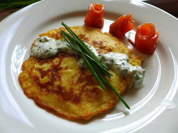 Image of potato and sweetcorn pancakes with smoked salmon and a yoghurt and chive sauce