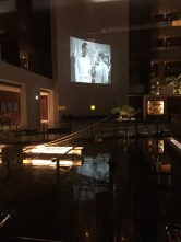 The hotel played classic movies in the lobby each night.