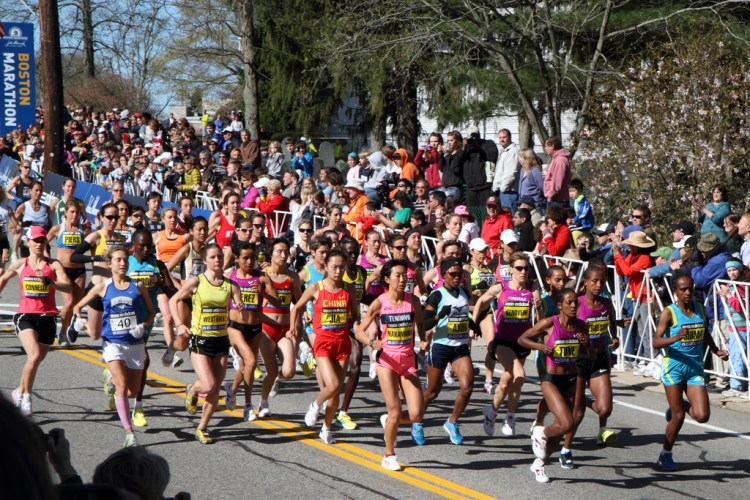 Boston marathon with people running in the street