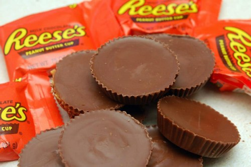 Reese peanut butter cups in a pile